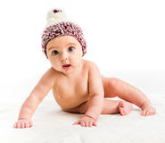 Baby girl in a brown hat Stock Photos