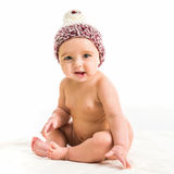 Baby girl in a brown hat Stock Photo