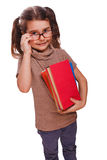 Baby girl brunette glasses reads the book keeps smiling isolated Royalty Free Stock Photos