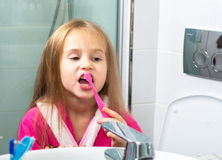 Baby Girl Brushing Her Teeth in the Morning at Bathroom Royalty Free Stock Photo