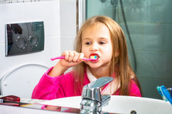 Baby Girl Brushing Her Teeth in the Morning at Bathroom Stock Photos