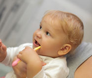 Baby girl brushing teeth Stock Photography