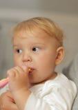 Baby girl brushing teeth Royalty Free Stock Images