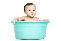 Baby girl in a bucket. A baby girl was playing in the bucket Stock Photography