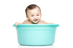 Baby girl in a bucket Royalty Free Stock Images