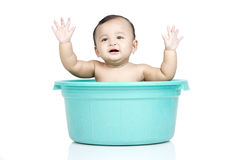 Baby girl in a bucket Royalty Free Stock Photography