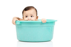 Baby girl in a bucket. A baby girl was playing in the bucket Royalty Free Stock Photography