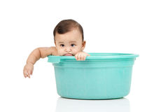 Baby girl in a bucket. A baby girl was playing in the bucket royalty free stock images