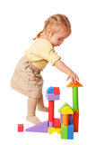 Baby girl building from toy blocks. Royalty Free Stock Photo