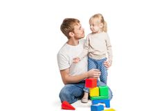 Baby girl building from toy blocks with her father Royalty Free Stock Photography