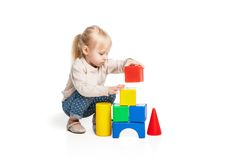 Baby girl building from toy blocks Royalty Free Stock Photo