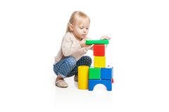 Baby girl building from toy blocks Stock Images