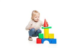 Baby girl building from toy blocks Royalty Free Stock Images