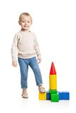 Baby girl building from toy blocks Stock Photos