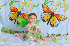 Baby girl with butterfly wings Stock Photo