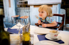Baby girl in cafe. Two years old baby girl in cafe royalty free stock photos