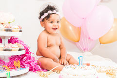 Baby Girl With Cake and Balloons Royalty Free Stock Photo