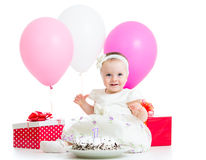 Baby girl with cake Royalty Free Stock Photos