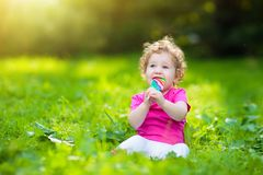 Baby girl with candy. Child with lollipop royalty free stock photography