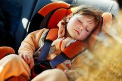 Baby girl  in car. Baby girl slip in car Stock Images