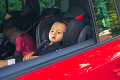 Baby girl in a car seat. For safety Stock Photography