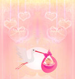 Baby girl Card - A stork delivering a cute baby girl. Stock Image