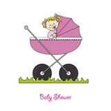 Baby girl in carriage Royalty Free Stock Photos