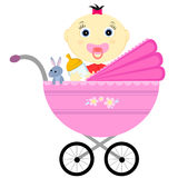 Baby girl in a carriage Royalty Free Stock Photo