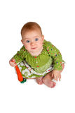 Baby girl with carrot in hand Royalty Free Stock Image