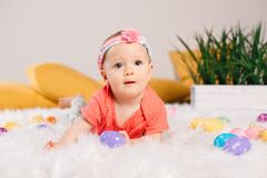 Baby girl celebrating Easter holiday Stock Photos