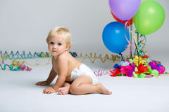 Baby girl celebrating her first bithday with gourmet cake. Stock Photo