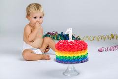 Baby girl celebrating her first bithday with gourmet cake. Royalty Free Stock Photography