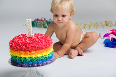 Baby girl celebrating her first bithday with gourmet cake. Stock Photos