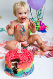 Baby girl celebrating her first bithday with gourmet cake. Royalty Free Stock Images
