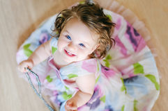 Baby-girl with chaplet Royalty Free Stock Images