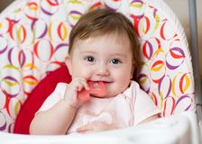Baby girl chewing on teething toy. First teeth. Cute baby chewing on teething toy. First teeth Royalty Free Stock Photography