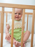 Baby girl in child bed Stock Images