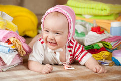 Baby girl with children's clothes Stock Images