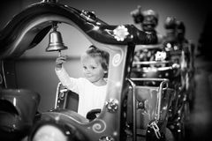 Baby girl on a choo-choo ride Stock Images