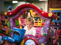 Baby girl on a choo-choo ride. Cure baby girl on a choo-choo ride Royalty Free Stock Photography