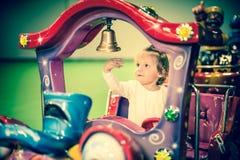 Baby girl on a choo-choo ride. Cure baby girl on a choo-choo ride Stock Photography