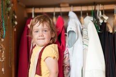 Baby girl  chooses dress Royalty Free Stock Photos