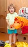 Baby girl  chooses dress Stock Image