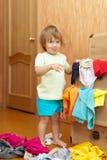 Baby girl  chooses dress Stock Photos