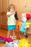Baby girl  chooses dress Royalty Free Stock Photo