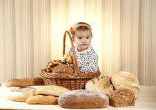 Baby girl choosing pastries Royalty Free Stock Images