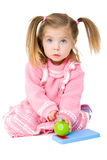 Baby Girl with chopping board. Picture of a baby girl cutting toy apple on a chopping board Royalty Free Stock Image