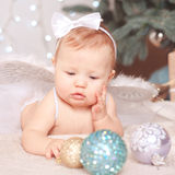 Baby girl with chrismas decor Stock Images