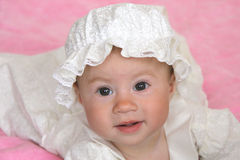 Baby girl in christening dress Stock Images