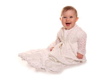 Baby girl in christening gown. Cutout Stock Photo